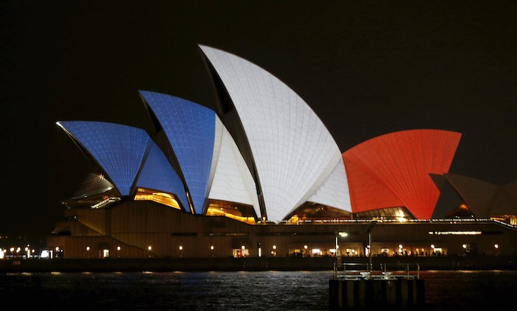 The blue, white and red colours of France's national flag are projected onto the sails of Sydney's Opera House in Australia November 14, 2015 following the attacks in Paris.      REUTERS/Jason Reed      TPX IMAGES OF THE DAY